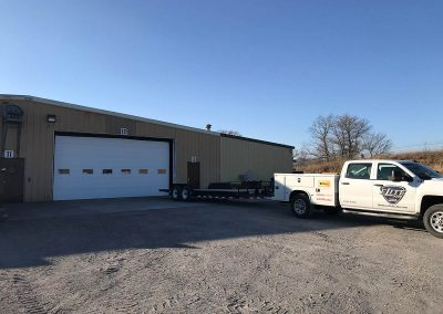 "Install Location: Norfolk, NE; Model: Clopay 3730; This 3"" Polyurethane door has an R-Value of 22.2. With industry leading R-Values, Elite Door is sure to keep your building highly insulated."